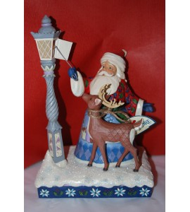 Santa Lighting a Lamp