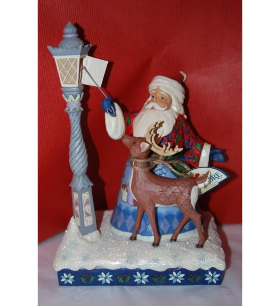 Santa Lighting a Lamp