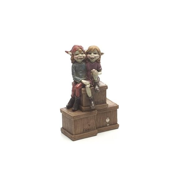 Couple de Pixies sur un Caisse